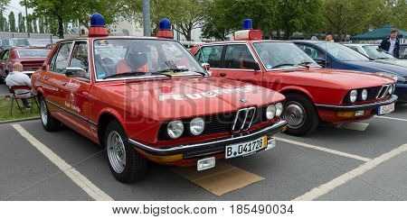 Berlin - May 11: Cars Rescue Bmw 5 Series (e28) In The Background, And The Bmw 5 Series (e12) In The