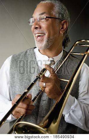 Smiling musician holding trombone