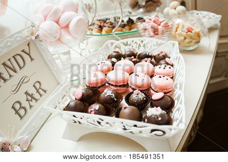 Candy bar. Banquet table full of desserts and an assortment of sweets. pie and cake. wedding or even.