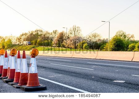 Evening view UK Motorway Services Roadworks Cones.