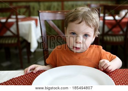 Boy With Toothpick