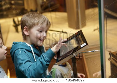 Child using touch screen in a museum