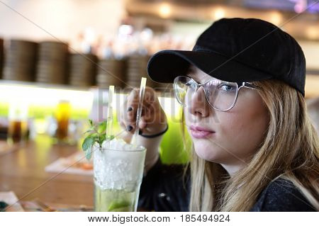 Teen Drinking Mojito
