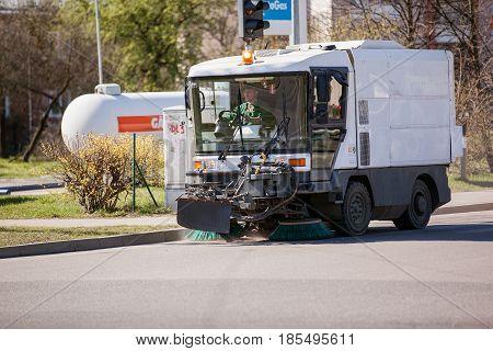 Riga, Latvia - May 5, 2017: Sweeper vehicle sweeping the street.