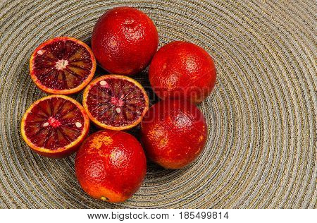 Sicilian orange ruby red oranges green background