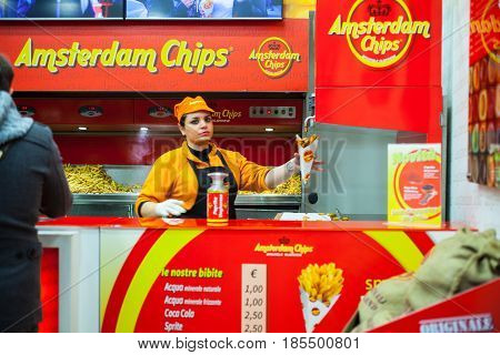 MILAN ITALY - FEBRUARY 26: Salesperson in the amsterdam chips shop on february 26 2017
