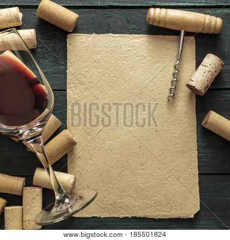 A piece of old parchment paper with a frame of corks, a glass of red wine, and a vintage corkscrew on a dark background. A retro-styled wine tasting invitation, square design template