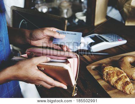 Customer Buying Fresh Baked Bread in Bakery Shop