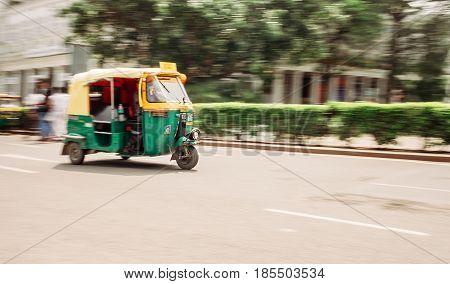 Moto Rickshaw in moution, New Delhi, India.