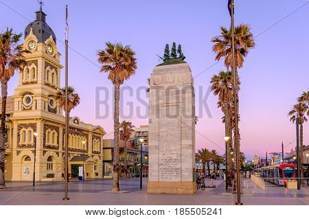 Adelaide Australia - November 11 2016: Moseley Square with Pioneer Memorial and tram at sunset. Moseley Square is a historical place and attracts a lot of tourists every day.