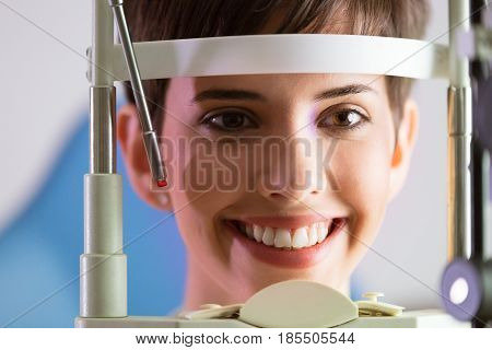Woman checking eyesight in a clinic. Ophthalmology. Medicine and health concept.