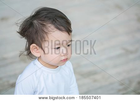 Closeup cute asian kid interest in something emotion with copy space