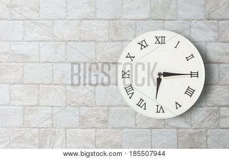 Closeup white clock for decorate show a quarter past six or 6:15 a.m. on old brick wall textured background with copy space in interior concept
