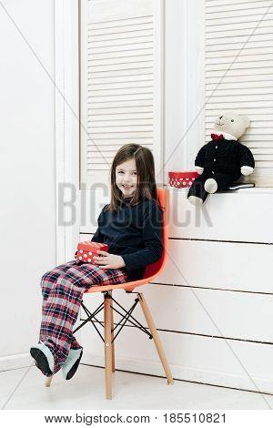 Happy Girl With Red Gift Box And Teddy Bear