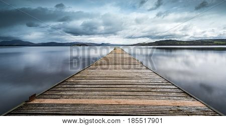 Looking out along the jettty at Loch Lomond just north of Glasgow Scotland