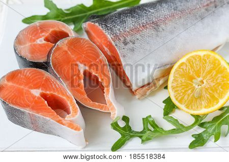fresh red fish - chopped carcass of red fish with lemon and arugula