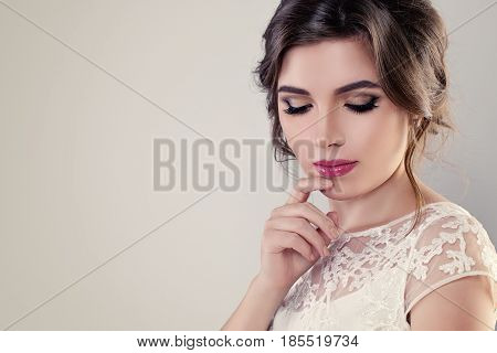 Bridal Makeup. Beautiful Young Woman Fiancee with Hairstyle and Wedding Make up