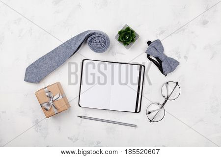 Happy Fathers Day mockup with notebook gift glasses necktie and bowtie on white background top view in flat lay style.