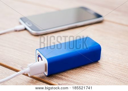 Mobile Phone And Battery Power Bank Charger On A Office Desk