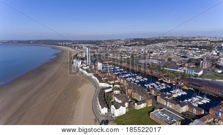Editorial SWANSEA, UK - APRIL 19, 2017: An aerial view of the Swansea City showing the marina, coastal housing, Leisure centre, Swansea market, County Hall and Meridian Tower.