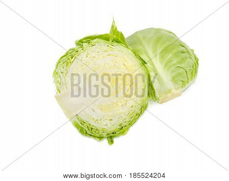 Two halves of a head of the young fresh white cabbage on a light background