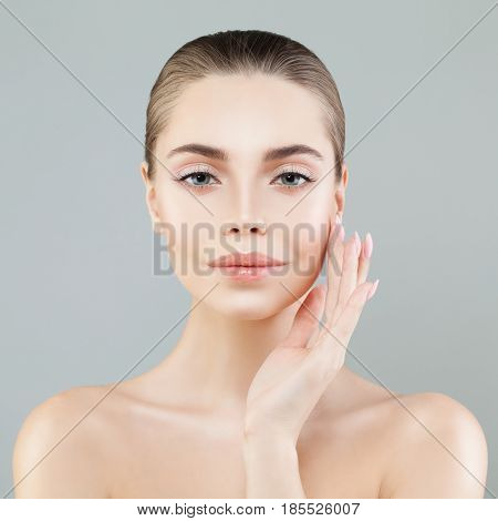 Spa Portrait of Healthy Model Woman with Fresh Skin. Facial Treatment Aesthetic Medicine and Cosmetology