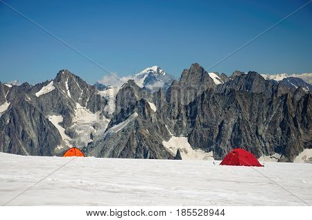 Touristic tents before mountains in Mont Blanc massive