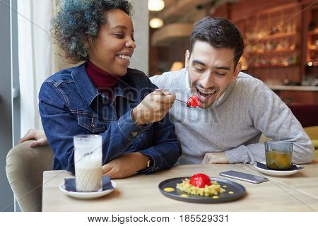 Closeup Of Interracial Lovers Enjoying Their Date Together And Spending Time In Cafe Where Dark-skin