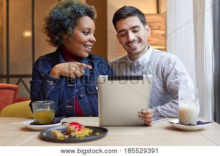 Indoor Portrait Of Two Young Lovers Spending Their Date Together In Cafe Drinking Coffee And Tea And