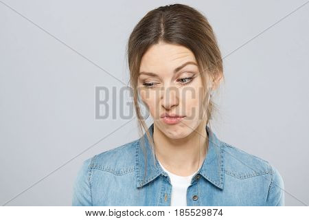 Closeup Portrait Of Skeptical Young Woman With Makeup Looking Suspicious Showing Negative Emotions W