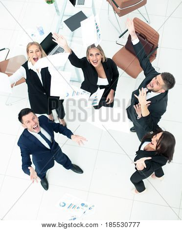 Happy business people throw into the air the documents