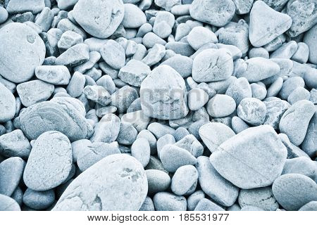 Close up beach stones, cold tone background