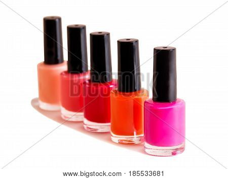 Group of nail polishes isolated on white background. Selective focus