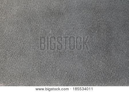 Gray suede texture or background, short fiber, closeup