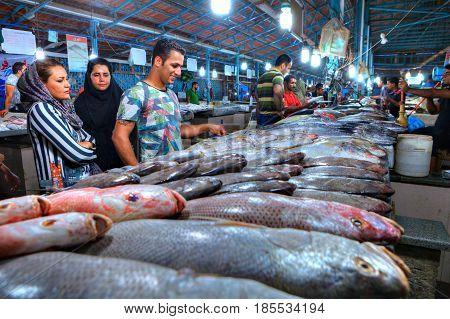 Bandar Abbas Hormozgan Province Iran - 15 april 2017: Muslim customers choose fresh fish at the covered fish market.