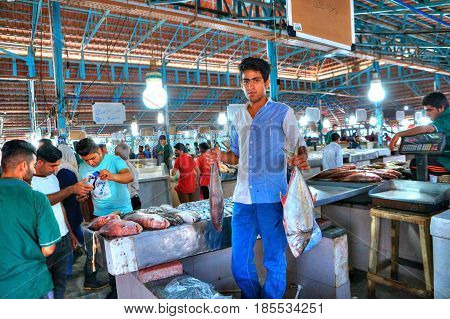 Bandar Abbas Hormozgan Province Iran - 16 april 2017: The young seller demonstrates its goods in the fish market.