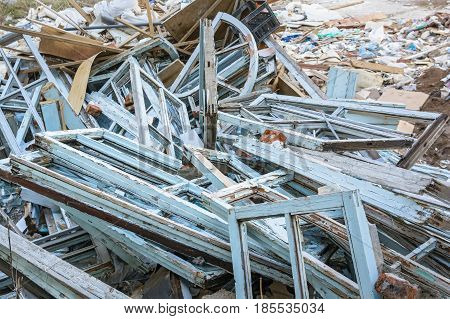 Close up image of industrial garbage dump with old wooden window frames