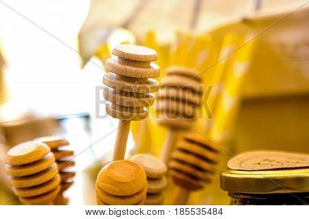 Close up honey sticks made of wood background