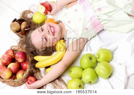 Cute Baby Girl Laying With Colorful Fruits In Basket