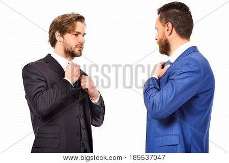 Businessmen In Blue And Black Suit Tying The Necktie
