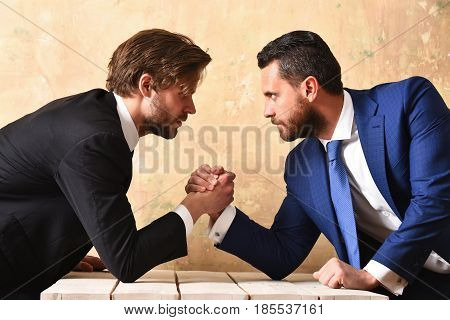Rivalry Concept. Businessmen Arm Wrestling.