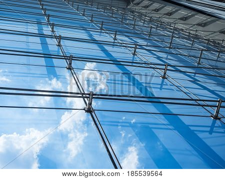 Architecture details Modern Building Glass facade reflection Sky