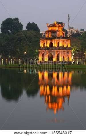 Turtle Tower on Hoan Kiem Lake in the evening twilight. Hanoi, Vietnam