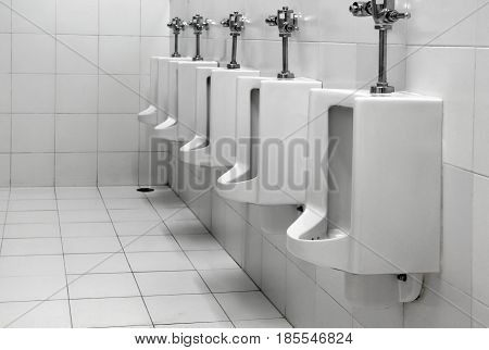 Row urinals white color in public restroom