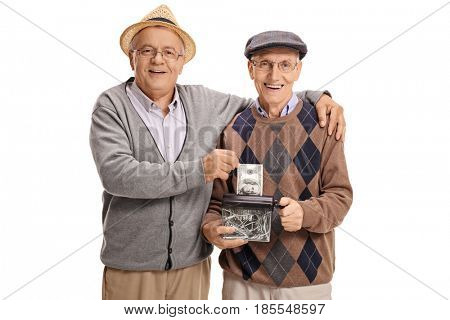 Seniors destroying a dollar in a paper shredder and looking at the camera isolated on white background