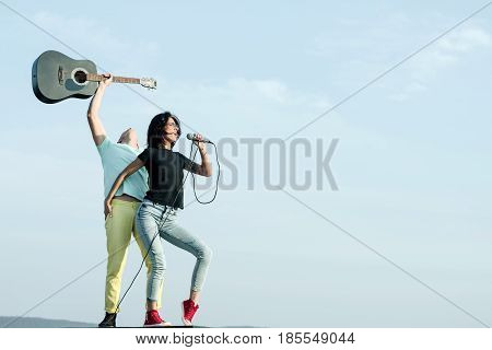 Sexy Singer Singing To Mic With Handsome Guitarist With Guitar