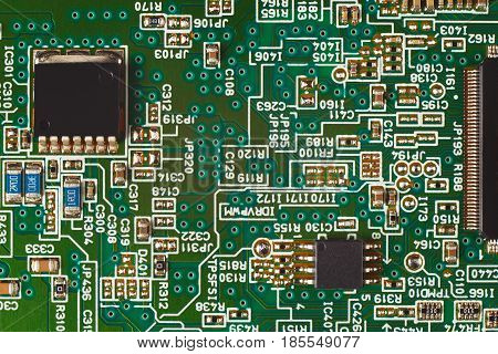 Microelectronic circuit board with components close up.