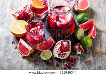 Sangria in pitcher with fresh fruits homemade refreshing lemonade drink