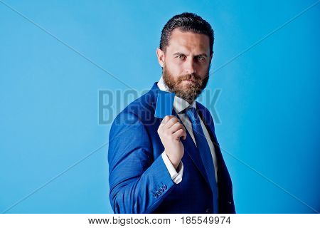 Man Holding Credit Card On Blue Background