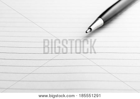 Opened notepad and pen on white background